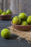 Fresh limes on the table Royalty Free Stock Photos