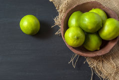 Fresh limes on the table Royalty Free Stock Photo