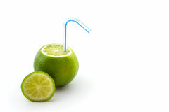 Fresh limes with tube. Royalty Free Stock Image