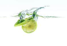 Fresh limes in water Royalty Free Stock Photos