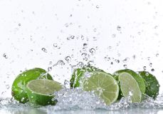 Fresh limes with water splash Royalty Free Stock Photography