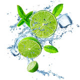 Fresh limes in water splash. Stock Images