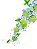 Fresh limes with water splash on white. Stock Images