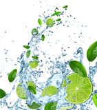 Fresh limes with water splash on white. Royalty Free Stock Photos