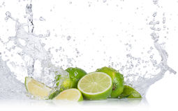 Fresh limes with water splashes Royalty Free Stock Photo