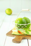 Fresh limes in a wire basket stock photo