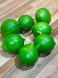 Fresh limes on wood counter Royalty Free Stock Photos