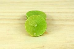 Fresh Limes on Wooden Background. stock photography