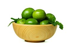 Fresh limes in wooden bowl Stock Photography