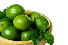 Fresh limes in wooden bowl Royalty Free Stock Image