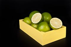 Fresh limes in a wooden box Royalty Free Stock Image