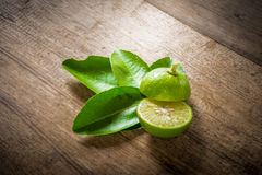 Fresh limes on wooden Stock Photo