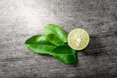 Fresh limes on wooden Royalty Free Stock Images