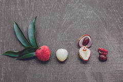 Fresh litchi fruit on an old wooden background Stock Images