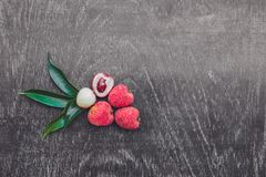 Fresh litchi fruit on an old wooden background Stock Image