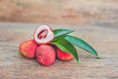 Fresh litchi fruit on an old wooden background.  Stock Image