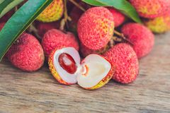 Fresh litchi fruit on an old wooden background.  Royalty Free Stock Image