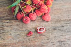 Fresh litchi fruit on an old wooden background Royalty Free Stock Image