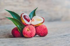 Fresh litchi fruit on an old wooden background.  Royalty Free Stock Images