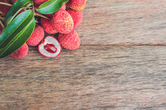 Fresh litchi fruit on an old wooden background.  Stock Photos