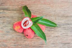 Fresh litchi fruit on an old wooden background Stock Photo