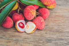 Fresh litchi fruit on an old wooden background.  Royalty Free Stock Photography