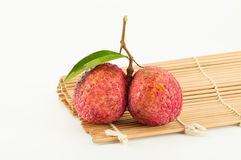 Fresh litchi on makisu Stock Photos