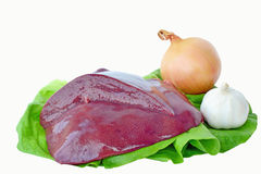 Fresh liver. Fresh pork liver with onion and garlic on a lettuce leaf against a white background stock photography