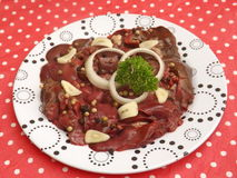 Fresh liver. Some raw liver of chicken meat with spices Stock Image