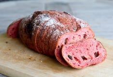 Fresh loaf of bread. Red yeast rise raisin walnut bread stock photo