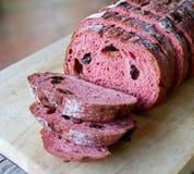 Fresh loaf of bread. Red yeast rise raisin walnut bread stock image