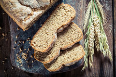 Fresh loaf of bread with several grains stock photography