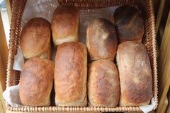Bloomer split tin white bread loafs in a wicker baskets