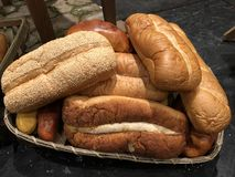 Fresh loaves of bread. Assorted freshly baked loaves of bread in a basket royalty free stock image