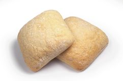 Fresh loaves of ciabatta. Two fresh loaves of ciabatta against a white background. Italian bread stock images