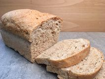 Fresh loaves of wheat bread. Whit many grains. Home bakery , slices of bread royalty free stock images