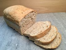 Fresh loaves of wheat bread. Whit many grains. Home bakery , slices of bread royalty free stock photos