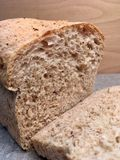 Fresh loaves of wheat bread. Whit many grains. Home bakery , slices of bread stock photography