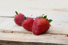 Fresh local strawberries macro shot on rustic wooden background Royalty Free Stock Photography