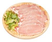 Fresh Loin Steaks. Fresh raw pork loin steaks on wooden plate. Isolated on white Stock Image