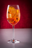 Fresh long drink, wine-based. Glass of exotic drink, wine-based; mixed drink with aperol, prossecco wine, soda, orange slices and ice Stock Photos