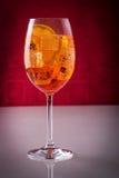 Fresh long drink, wine-based. Glass of exotic drink, wine-based; mixed drink with aperol, prossecco wine, soda, orange slices and ice stock photos