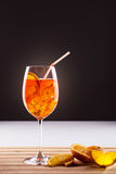 Fresh long drink, wine-based spritz. Glass of exotic drink, wine-based; mixed drink with aperol, prossecco wine, soda, orange slices and ice Stock Photos
