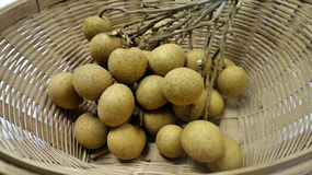 Fresh longan in bamboo basket Stock Image