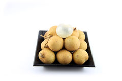 Fresh Longan placed in a black dish. Stock Photos