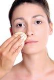 Fresh look-step 1-tan. Young woman, close up, applying make-up Royalty Free Stock Image