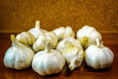 Garlic loose on a cork wood background. Royalty Free Stock Image