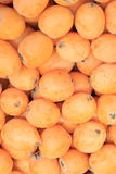 Fresh loquat in a street market. Bright orange background ripe loquat stock photography