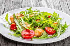 Fresh low-calories salad with chicken breast, arugula and tomato Stock Image