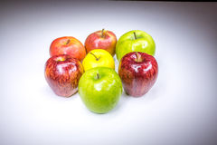 Fresh lucky seven multicolored apples. Painted in light stock photos